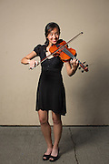 Sharlene Reyes, MHS sophomore, poses for a portrait with her viola before performing in the Milpitas Unified School District's 11th Annual Music Festival at Milpitas High School in Milpitas, California, on April 10, 2014. (Stan Olszewski/SOSKIphoto)
