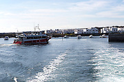 Tourist ferry boat arriving in Orzola harbour from La Graciosa, Lanzarote, Canary Islands, Spain