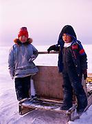 Inupiat children rodney and Jonna playing on sled, village of Wainwright, Arctic Coast of Alaska.