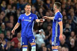 May 8, 2017 - Chelsea, Greater London, United Kingdom - L-R Chelsea's John Terry gets captains arm bend from Chelsea's Gary Cahill.during Premier League match between Chelsea and Middlesbrough at Stamford Bridge, London, England on 08 May 2017. (Credit Image: © Kieran Galvin/NurPhoto via ZUMA Press)