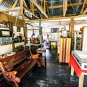Interior of the exhibit room of the museum on Radio Peten Island. Off the western side of the island of Flores is another much smaller island known simply as Radio Peten after the radio station that has broadcast from there since 1947. There are only a handful of buildings on the island, one of which is a small, one-room museum of Maya artifacts and various radio, telephone, and other artifacts. The only way to approach the island is by boat.