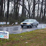 CHARLOTTE, NC - MARCH 3: A car passes by a collection of Mike Bloomberg campaign signs on the onramp to interstate 85 at Beatties Ford Road on the day of the the North Carolina primary on Super Tuesday in Charlotte, NC on March 3, 2020. North Carolina will be the 3rd largest haul of delegates at 110. (Photo by Logan Cyrus for AFP)