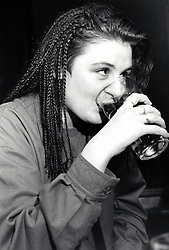 Young woman drinking Nottingham UK 1989