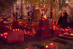 """© Licensed to London News Pictures. 16/11/2019. Bristol, UK. """"Light the Night"""" in the grounds of St Paul's Church churchyard on Coronation Road with a sea of light as 5,000 candles are lit for the inaugural Light the Night event. Shielded candles were placed around the churchyard by volunteers to create a event for everybody to come and celebrate family and remembrance of loved ones. Attendees could buy and light a candle in remembrance of their loved ones. The event was inspired by the celebrations of All Souls Day and the tradition of Eastern European churches. Photo credit: Simon Chapman/LNP."""