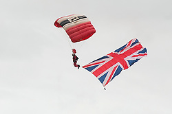 In the Shadow of Sterling Castle and Walace's Monument 1,000's of servicemen and women take part in the 6th Annual Armed Forces Day. <br /> Trailing the Union Flag Members of the Red Devils drop into the main Arena<br /> <br /> June 29 2014<br /> Copyright Paul David Drabble<br /> www.pauldaviddrabble.co.uk