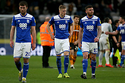 Birmingham City's Gary Gardner,Birmingham City's Kristian Pedersen and Birmingham City's Harlee Dean appear dejected after the final whistle