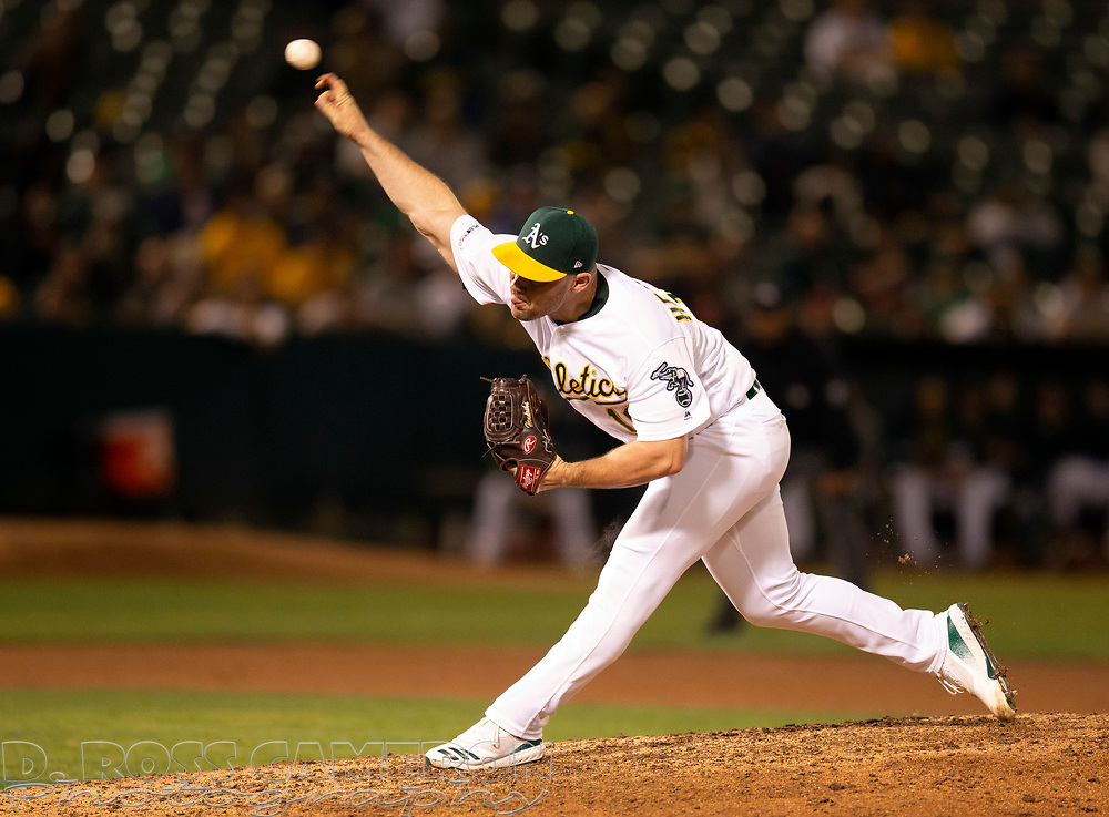 Sep 17, 2019; Oakland, CA, USA; Oakland Athletics pitcher Liam Hendriks (16) delivers against the Kansas City Royals during the ninth inning of a baseball game at Oakland Coliseum. Mandatory Credit: D. Ross Cameron-USA TODAY Sports