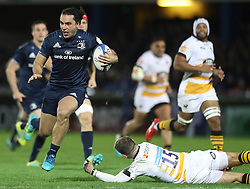 Leinster's James Lowe evades being tackled by Willie le Roux of Wasps during the Champions Cup match at the RDS Arena, Dublin.