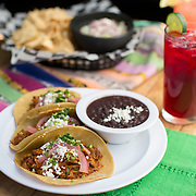 Tucson, AZ -- 09/29/2017<br /> <br /> Conchinita Pibil tacos served on small handmade corn tortillas with cilantro and red onion; and guacamole and chips and seasonal aqua fresca drinks from Seis located at Mercado San Agustin <br /> <br /> Photography by Jill Richards