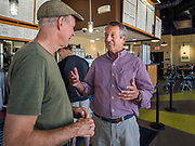 23 SEPTEMBER 2019 - DES MOINES, IOWA: MARK SANFORD, right, the former Republican Governor of South Carolina and six term Congressman from South Carolina, talks to people at Zombie Burger, a Des Moines restaurant, Monday. Sanford is challenging incumbent President Donald Trump for the Republican nomination for the US presidency. Iowa hosts the first event of the presidential selection cycle. The Iowa Caucuses are scheduled for February 3, 2020.           PHOTO BY JACK KURTZ