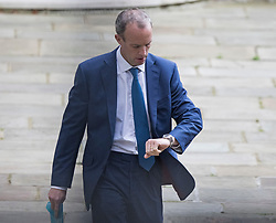 © Licensed to London News Pictures. 23/08/2021. London, UK. Foreign Secretary DOMINIC RAAB is seen checking his watch as he leaves the Foreign Office in Westminster. Raab is under pressure after it was revealed that he failed to make a telephone call to Afghanistan's foreign minister to request assistance with evacuating Afghan interpreters. Photo credit: Ben Cawthra/LNP