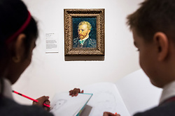 "© Licensed to London News Pictures. 25/03/2019. LONDON, UK. Pupils from Millbank Primary Academy sketch  ""Self-Portrait"", 1887, by Vincent Van Gogh.  Preview of ""The EY: Van Gogh and Britain"" exhibition at Tate Britain, the first exhibition to look at the work of Vincent Van Gogh through his relationship with Britain and how he inspired British artists.  Over 50 of his works are on display 27 March to 11 August 2019.  Photo credit: Stephen Chung/LNP"