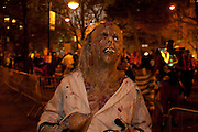 A zombie gets ready to join the parade.