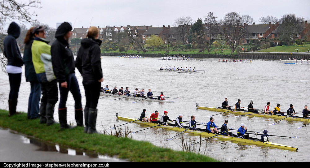 © Licensed to London News Pictures. 17/03/2012. London, UK. People watch the race from the river bank. Crews participate in the rain today,  Saturday 17th March, in The Head of the River Race which is rowed annually in March from Mortlake to Putney on the River Thames in London.  Over 400 crews of eights take part, making it one of the highest participation events in London.. Photo credit : Stephen SImpson/LNP