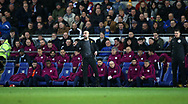 Pep Guardiola, the Manchester city manager and his back room team look on from the dugout. The Emirates FA Cup, 4th round match, Cardiff city v Manchester City at the Cardiff City Stadium in Cardiff, South Wales on Saturday 28th January 2018.<br /> pic by Andrew Orchard, Andrew Orchard sports photography.