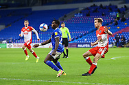 Cardiff City's Sheyi Ojo (27) under pressure from Millwalls's Maikel Kieftenbeld (16) during the EFL Sky Bet Championship match between Cardiff City and Millwall at the Cardiff City Stadium, Cardiff, Wales on 30 January 2021.