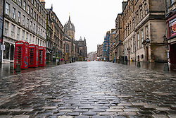 Edinburgh, Scotland, UK. 20 January 2020. Views of quiet streets in Edinburgh city centre on day after First minister Nicola Sturgeon announced national lockdown would be extended into February. Streets remain very quiet with no non essential shops open. Pic; The Royal Mile in the Old Town is almost deserted.  Iain Masterton/Alamy Live News