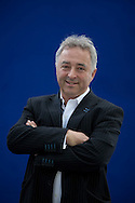 British screenwriter and author Frank Cottrell Boyce, pictured at the Edinburgh International Book Festival where he talked about his latest writing. The three-week event is the world's biggest literary festival and is held during the annual Edinburgh Festival. The 2012 event featured talks and presentations by more than 500 authors from around the world..