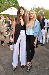 Left to right, DOINA CIOBANU and TALLIA STORM at a party to launch the Taylor Morris Explorer Collection held at the Serpentine Lido, Hyde Park, London on 11th May 2016.