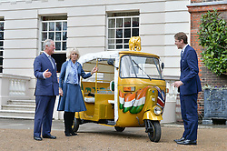 Thursday 26th March 2015, The Elephant Family charity and Quintessentially Foundation announced the launch of 'Travels To My Elephant' – a once-in-a-lifetime rickshaw race taking place in India in November 2015. The official launch of the venture took place at Clarence House at an exclusive reception hosted by TRH The Prince of Wales and The Duchess of Cornwall,  joint patrons of Elephant Family.<br /> Picture Shows:- Prince of Wales, the Duchess of Cornwall, Ben Elliot,