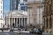 Pedestrians and traffic mingle at Bank junction, in front of Royal Exchange and up Cornhill Street in the City of London, the capitals financial district, on 21st September 2021, in London, England. Post-Covid pandemic, City workers are returning to their office desks in greater numbers but many still prefer to work from home for at least 1-2 days a week.