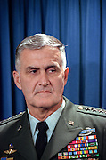 US Joints Chief General Hugh Shelton looks on as President Bill Clinton makes a statement in the Briefing Room of the White House November 15, 1998 in Washington, DC. Clinton announced that he called off airstrikes on Iraq after Saddam Hussein agreed to allow the UN to resume weapon inspections.