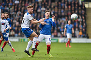 Rochdale Midfielder, Callum Camps (10) and Portsmouth Midfielder, Ronan Curtis (11) challenge for the ball during the EFL Sky Bet League 1 match between Portsmouth and Rochdale at Fratton Park, Portsmouth, England on 13 April 2019.