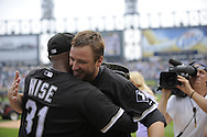 CHICAGO - JULY 23:  Mark Buehrle #56 of the Chicago White Sox hugs outfielder DeWayne Wise #31 who made a spectacular catch in the ninth inning enabling Buehrle to record the 18th perfect game in major league history against the Tampa Bay Rays on June 23, 2009 at U.S. Cellular Field in Chicago, Illinois.  The White Sox defeated the Rays 5-0.  (Photo by Ron Vesely)