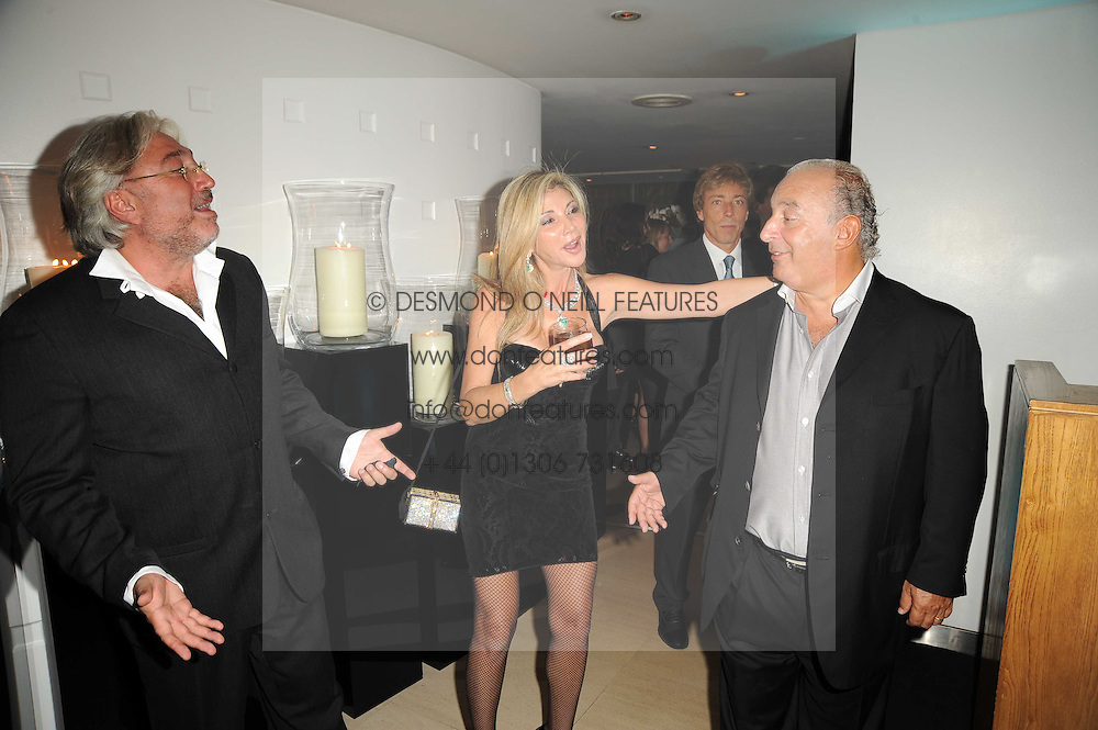 Left to right, ROBERT TCHENGUIZ, his sister LISA TCHENGUIZ and SIR PHILIP GREEN at the launch party for 'Promise', a new capsule ring collection created by Cheryl Cole and de Grisogono held at Nobu, Park Lane, London on 29th September 2010.