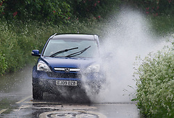 © Licensed to London News Pictures 04/06/2021. Crockenhill, UK. No more sunny weather today as the rain makes a comeback in Kent as roads start to flood in Crockenhill, Kent. Photo credit:Grant Falvey/LNP