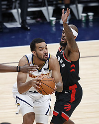 December 16, 2018 - Denver, Colorado, U.S - Nuggets TREY LYLES, left, goes up for a shot during the 2nd. Half at the Pepsi Center Sunday evening. The Nuggets beat the Raptors 95-86. (Credit Image: © Hector Acevedo/ZUMA Wire)