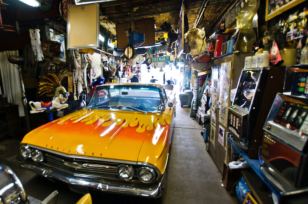 Collectibles of all sorts and even several Chevrolet cars in Ralph's garage, Red Hook, Brooklyn