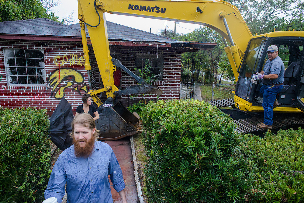 Photo by Matt Roth..Jonathan Tennis and his wife Angelina Tennis watch as an excavator destroys the house he bought in 2005 in Tampa, Florida on Friday, April 05, 2013.