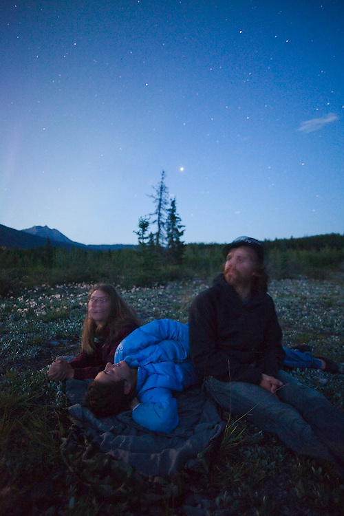 Lindsey Pepper, Bonnie Bzdok and Brian, all three summer employees in McCarthy, Alaska, stay up late at night stargazing in the hopes of seeing the northern lights.