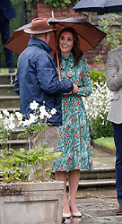 The Duchess of Cambridge is shown around the White Garden in Kensington Palace, London, during a visit to meet with representatives from charities supported by Diana, the Princess of Wales.