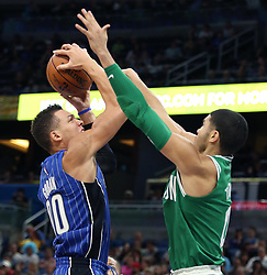 November 5, 2017 - Orlando, FL, USA - Boston Celtics forward Jason Tatum (right) blocks a shot by Orlando Magic forward Aaron Gordon (left) on Sunday, Nov. 5, 2017 at the Amway Center in Orlando, Fla. Boston won the game, 104-88. (Credit Image: © Stephen M. Dowell/TNS via ZUMA Wire)