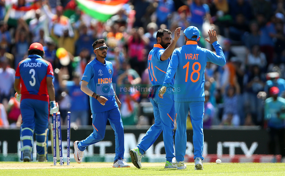 India's Mohammed Shami (centre right) celebrates taking the wicket of Afghanistan's Hazrat Zazai during the ICC Cricket World Cup group stage match at the Hampshire Bowl, Southampton.