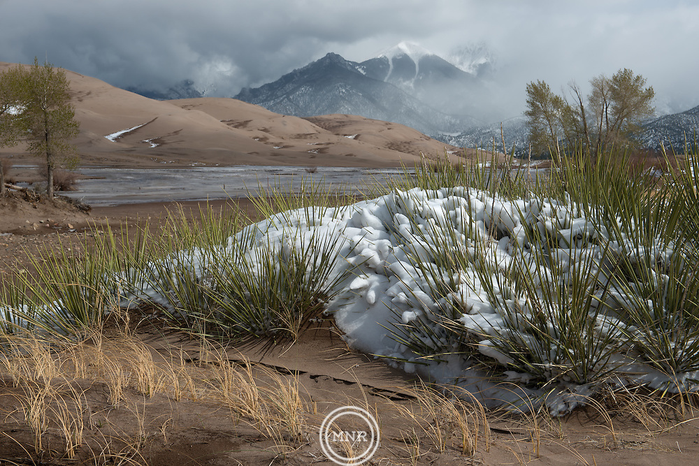 A late spring snow storm clears from the Great Sand Dunes National Park and Preserve.