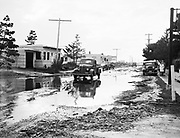 9969-7365. Drenched street in Oceanlake, Oregon, resulting from severe coast storm. November 3, 1948.