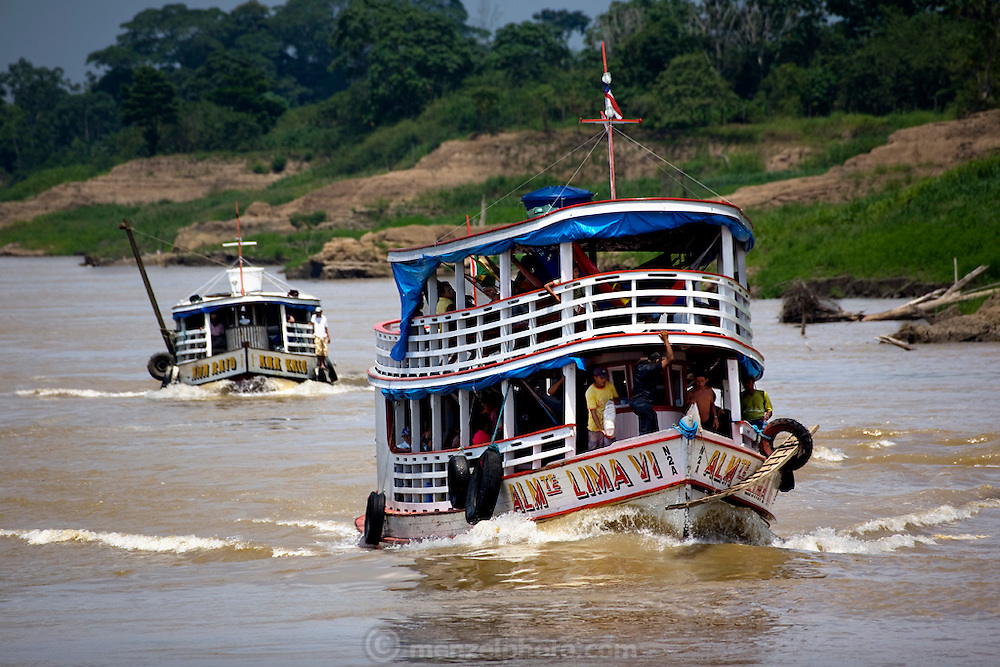 Riverboat traffic near Manacapuru  Brazil steams along the Solimoes River. (From the book What I Eat: Around the World in 80 Diets.) Riverboats ply the network of rivers that drain the vast Amazon basin. In the dry season the banks of the Solimoes are exposed, but during the rainy season the water rises 40 feet to the top of the banks, filling inland lakes and depositing a blanket of silt.