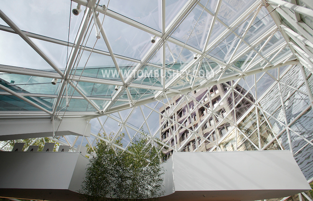 The Haggerty Administration Building, in the background at right at SUNY New Paltz is visible through the glass roof of the Atrium during the grand opening on Monday, Sept. 13, 2010.