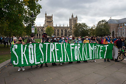 © Licensed to London News Pictures; 22/10/2021; Bristol, UK. A pre-COP26 Bristol Youth Strike 4 Climate protest takes place in the city centre. Students and staff from Bristol and Bath universities, colleges, and schools to protest inaction of governments globally, and about the lack of progress by Bristol City Council in tackling the climate and ecological crisis, on issues of clean air, Bristol airport expansion and climate justice. Photo credit: Simon Chapman/LNP.