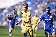 Dna Harding of Millwall (l) breaks away from Cardiff's Eoin Doyle. Skybet football league championship, Cardiff city v Millwall at the Cardiff city stadium in Cardiff, South Wales on Saturday 18th April 2015<br /> pic by Andrew Orchard, Andrew Orchard sports photography.