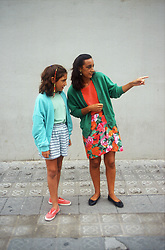 Woman standing in street in Gerona; Catalunya; giving directions to young girl,