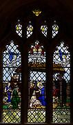 Stained glass window of nativity church of Saint Mary, Hemington, Somerset, England, UK