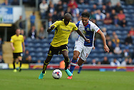 Ben Marshall of Blackburn Rovers puts Lloyd Dyer of Burton Albion under pressure during the EFL Sky Bet Championship match between Blackburn Rovers and Burton Albion at Ewood Park, Blackburn, England on 20 August 2016. Photo by Simon Brady.