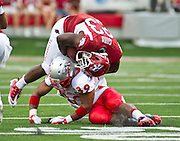 Sep 10, 2011; Little Rock, AR, USA; Arkansas Razorback running back De'Anthony Curtis (23) is brought down by New Mexico Lobos linebacker Joe Stoner (39) during the first half of a game at War Memorial Stadium.  Mandatory Credit: Beth Hall-US PRESSWIRE