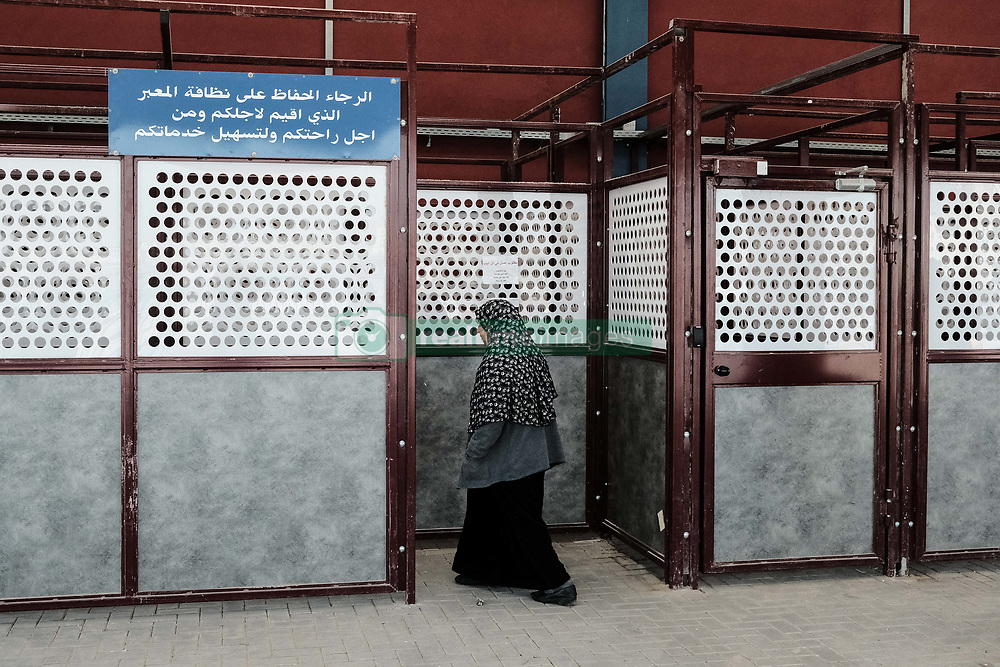 March 28, 2019 - Jerusalem, Israel - A woman enters the Qalandiya Crossing for processing and entry to Jerusalem. $11 million renovations have recently been completed at the Qalandiya Crossing, the main crossing between northern Judea and Samaria and Jerusalem. Renovations were carried out in order to enhance processing of some 7,000 Palestinians every day, entering Jerusalem for work, medical care or other necessities. Upgrades include implementation of technology available at modern airports while giving consideration to security requirements. Processing of an incoming Palestinian now takes between 4-7 minutes. (Credit Image: © Nir Alon/ZUMA Wire)