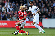 Adama Traore of Middlesbrough (l) and Leroy Fer of Swansea city ® in action. Premier league match, Swansea city v Middlesbrough at the Liberty Stadium in Swansea, South Wales on Sunday 2nd April 2017.<br /> pic by Andrew Orchard, Andrew Orchard sports photography.