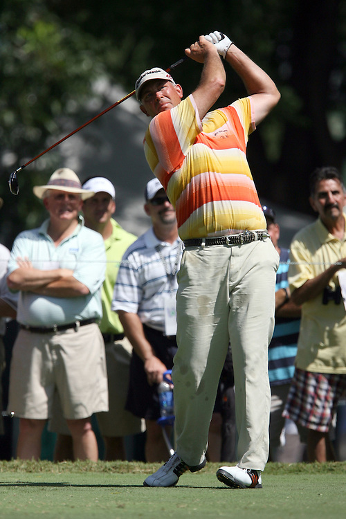 09 August 2007: Tom Lehman tees off on the 4th hole during the first round of the 89th PGA Championship at Southern Hills Country Club in Tulsa, OK.